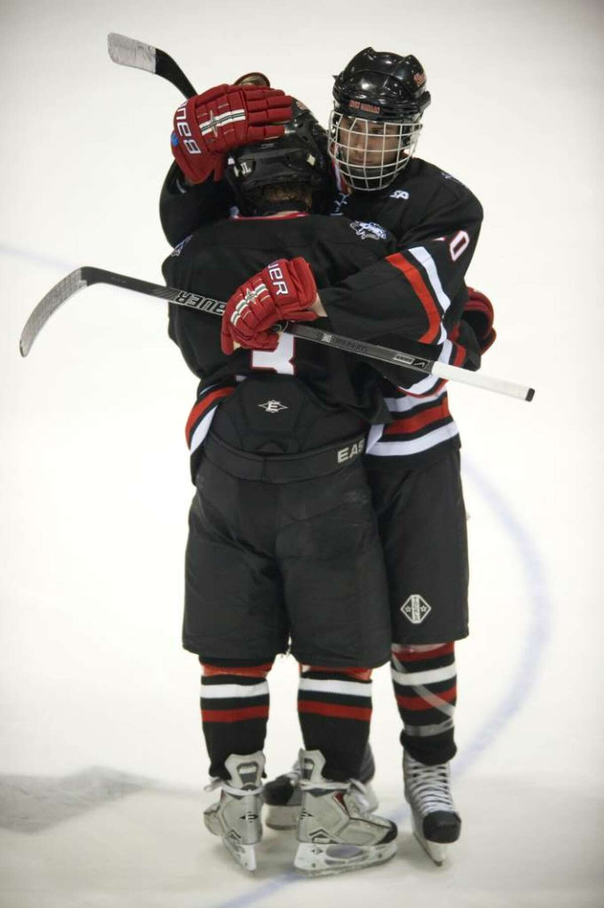 New Canaan's Andrew Leslie, left, and Jake Granito, right, react to losing to Fairfield Prep in the 2010 CIAC Division I boys ice hockey state semifinal game at Ingalls Rink in New Haven, Conn. on Thursday, March 18, 2010.