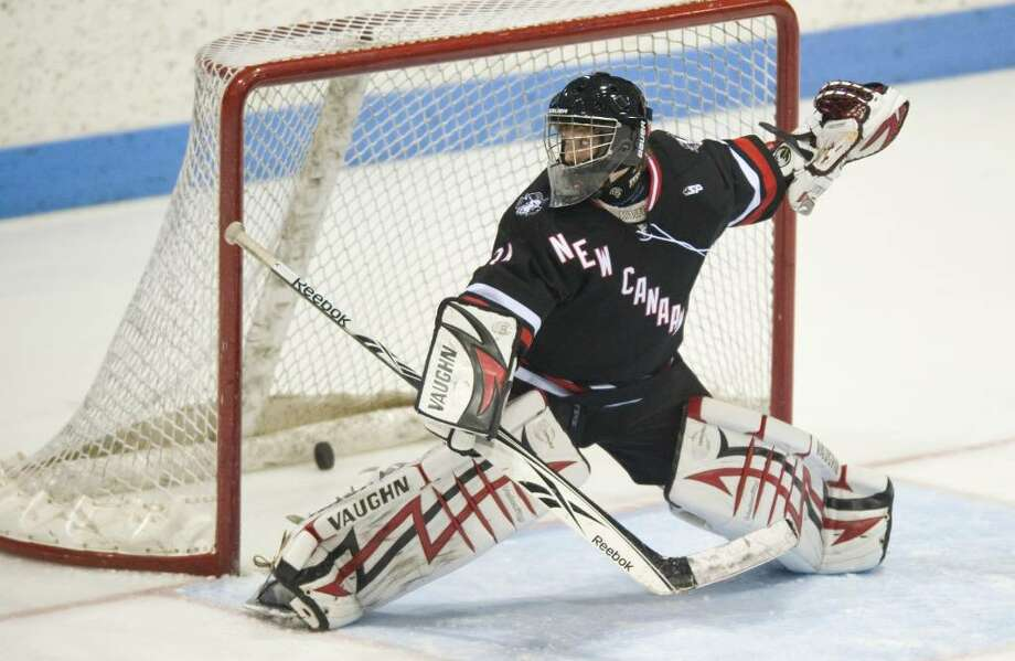 New Canaan's Tim Nowacki lets one slip past during the 2010 CIAC Division I boys ice hockey state semifinal game against Fairfield Prep at Ingalls Rink in New Haven, Conn. on Thursday, March 18, 2010. Photo: Chris Preovolos / Stamford Advocate