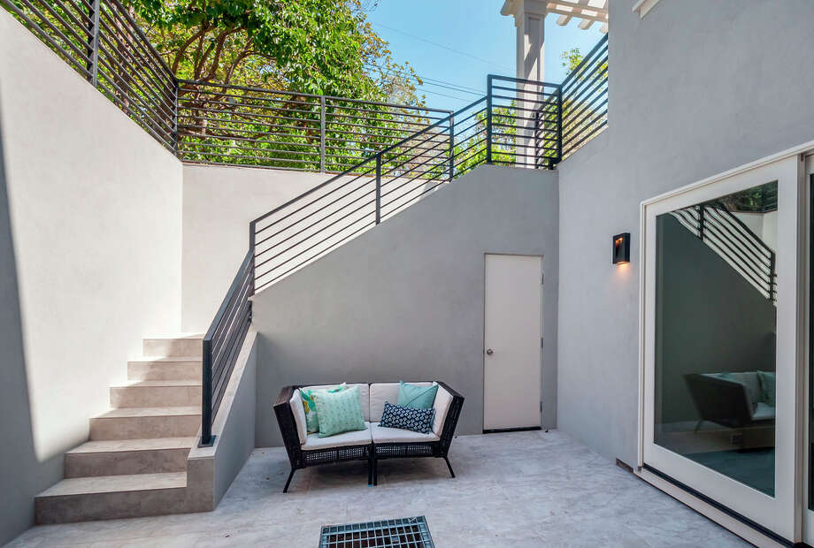 This courtyard sheds light into the 1,894-square-foot basement at 1015 Atkinson in Menlo Park / ONLINE_YES