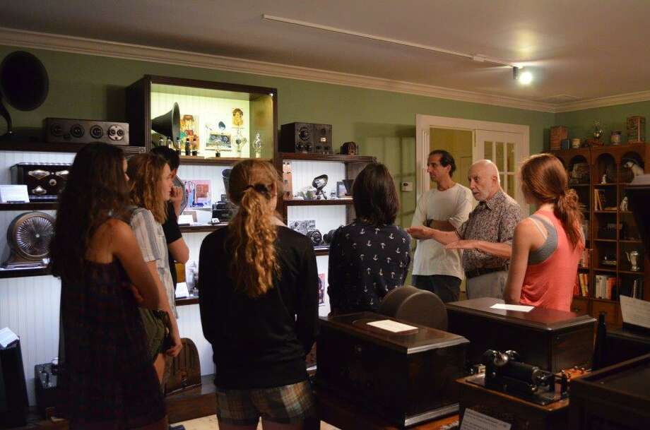 "Stamford resident Bob Barker, second from right, shows a group of teenage girls his at-home ""museum"" of old radios, phonographs and antique medical contrivances. Photo: Contributed / Bob Barker / Stamford Advocate"