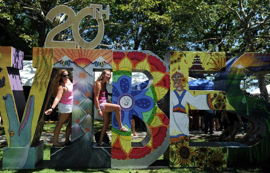 Friends, Megan Donahue, of East Lyme, and Emma Henry, of Trumbull, right, pose for a photograph during the 20th annual Gathering of the Vibes music festival Friday, July 31, 2015 at Seaside Park in Bridgeport, Conn. Photo: Autumn Driscoll, Hearst Connecticut Media / Connecticut Post freelance