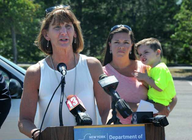 "Terri Egan, executive deputy commissioner of DMV, speaks during an event to remind parents and caregivers to ""look before you lock"" during National Heatstroke Prevention Day at Colonie Center on Friday, July 31, 2015 in Colonie, N.Y. More than 30 children in the U.S., including one from New York State, died from heatstroke after being left in a hot vehicle in 2014. Parent Leslie Carroll of Cohoes holds her son Matthew, 2. (Lori Van Buren / Times Union) Photo: Lori Van Buren / 10032849A"