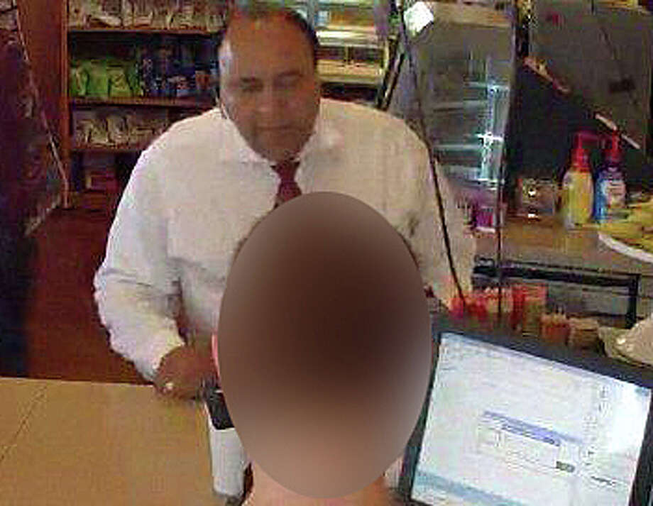 Police are asking for help identifying this man, who they say is suspected of stealing another customer's wallet at a local convenience store. Photo: Westport Police Department / Westport Police Department / Westport News