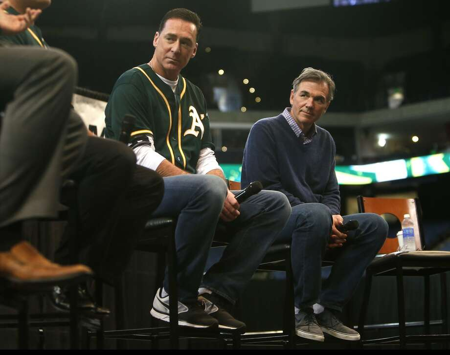 A's general manager Billy Beane (right, with manager Bob Melvin) seems to be planning for a future that may never come. Photo: Scott Strazzante, The Chronicle