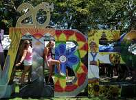 Friends, Megan Donahue, of East Lyme, and Emma Henry, of Trumbull, right, pose for a photograph during the 20th annual Gathering of the Vibes music festival Friday, July 31, 2015 at Seaside Park in Bridgeport, Conn.