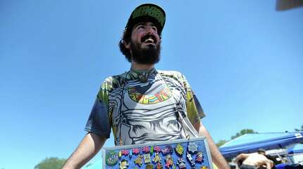 Newtown resident Zach Pettengill, of A-Z Creations, makes and sells buttons at the 20th annual Gathering of the Vibes music festival Friday, July 31, 2015 at Seaside Park in Bridgeport, Conn.