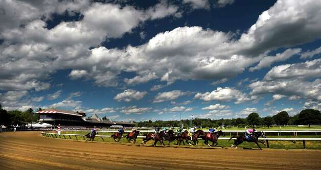 The fifth race on the card makes enters the apex of the Clubhouse turn on an extraordinarily beautiful Friday afternoon July 31, 2015  at the Saratoga Race Course in Saratoga Springs, N.Y.   The eventual winner was  #3 Gangster ridden by jockey Jose L. Ortiz and trained by Todd Pletcher   (Skip Dickstein/Times Union) Photo: SKIP DICKSTEIN