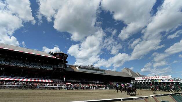 The 7th running of the Curlin breaks the gate on an extraordinarily beautiful Friday afternoon July 31, 2015  at the Saratoga Race Course in Saratoga Springs, N.Y.   The eventual winner was  #5 Smart Transition ridden by jockey Junior Alvarado and trained by John Shereffs.    (Skip Dickstein/Times Union) Photo: SKIP DICKSTEIN