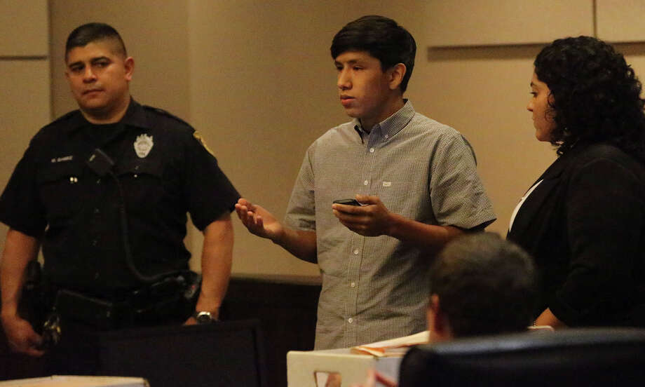 "Ahn Cisneros, 17, reads a victim's impact statement to Jose Gonzalez, who was found guilty of shooting to death his father. The teen said he forgives Gonzalez, who nodded his head and mouthed the words ""thank you"" when Ahn finished reading. Photo: John Davenport / San Antonio Express-News / ©San Antonio Express-News/John Davenport"