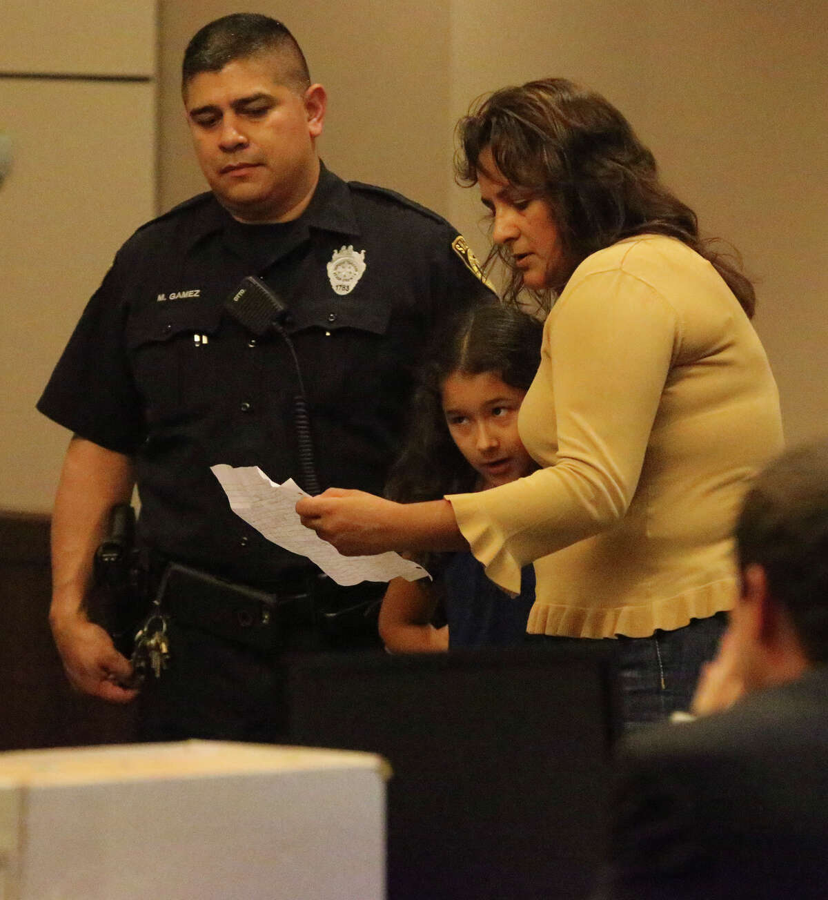 ABOVE: Monica Cervera helps Angelica Cervera, 8, read a statement to Jose Gonzalez after he was sentenced for killing Angelica's father.