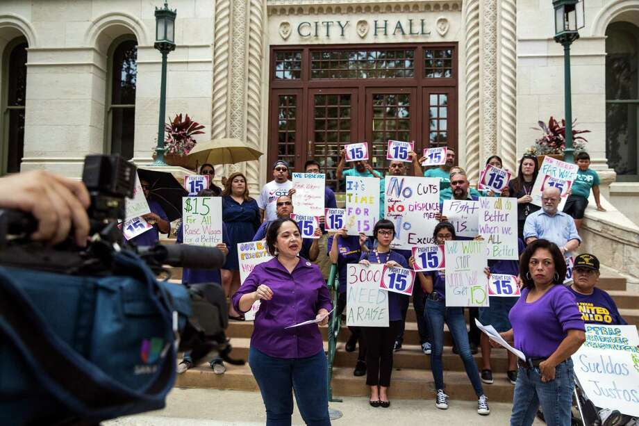 SEIU President Elsa Caballero speaks to the media at City Hall in San Antonio, Texas during a press conference in which SEIU and Fight for 15 supporters requested that the city raise the minimum wage for city employees to $15 per hour. Photo: Ray Whitehouse, Staff / San Antonio Express-News / 2015 San Antonio Express-News