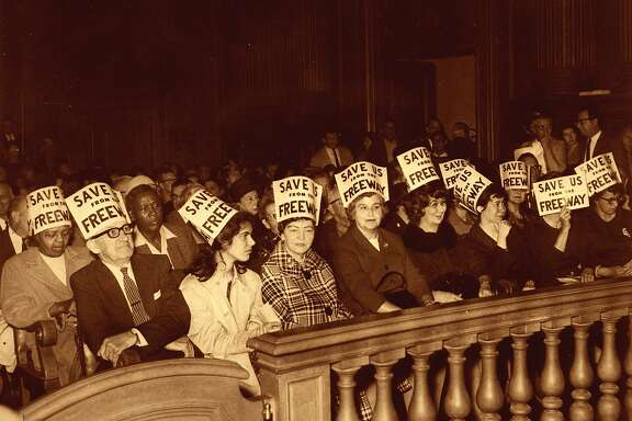 """freeway protest.jpg  Freeway foes who crowded into the San Francisco board of supervisors hearing expressed their sentiments on their hats.  The writing says, """"Save us from the freeway.""""  The hearing was on the topic of the Panhandle and Golden Gate Freeways.  Photo taken Febraury 23, 1966.  Bill Young Chronicle File  150 Anniversary maybe"""