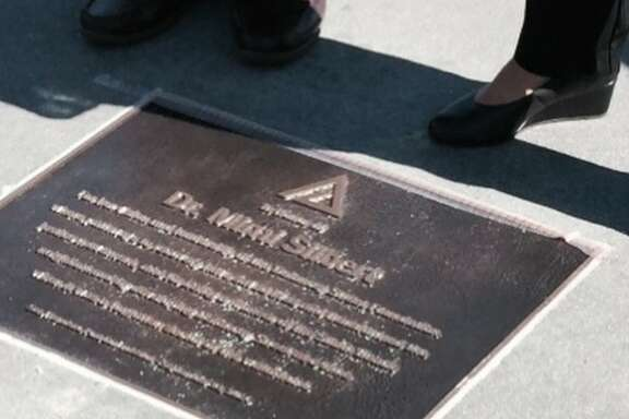 The bronze Pathway plaque, honoring Dr. Mimi Silbert