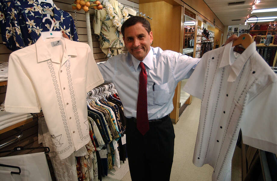 Mark Penner shows off Guayaberas at Penner's on Monday, May 17, 2004. ( JERRY LARA STAFF ) Photo: JERRY LARA, STAFF / SAN ANTONIO EXPRESS-NEWS / SAN ANTONIO EXPRESS-NEWS