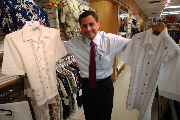 Mark Penner shows off Guayaberas at Penner's on Monday, May 17, 2004. ( JERRY LARA STAFF )