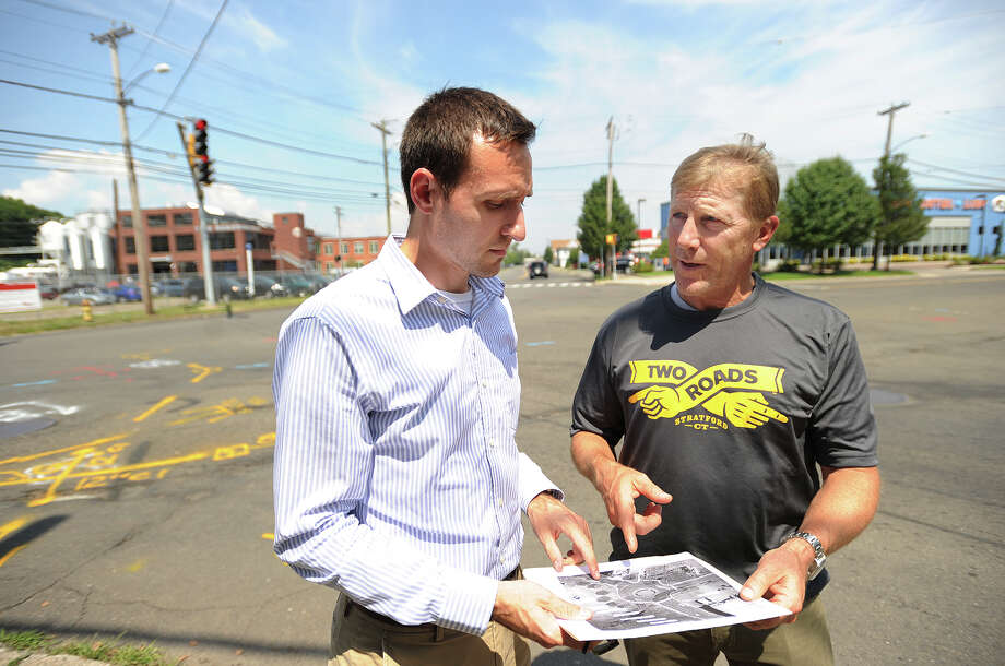 Town of Stratford Constituent Service and Outreach Coordinator Christopher Bandecchi, left, and Two Roads Brewing Company CEO Brad Hittle look over a rendering of a roundabout planned for the busy intersection outside the brewery on Stratford Avenue in Stratford, Conn. on Tuesday, July 29, 2015. Photo: Brian A. Pounds / Hearst Connecticut Media / Connecticut Post