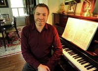 Joshua Gersen, new assistant conductor of the New York Philharmonic, at his parent's home in Fairfield. Gersen grew up in Monroe, where he graduated from Masuk High School. He will conduct his first concert with the orchestra on Dec. 12.