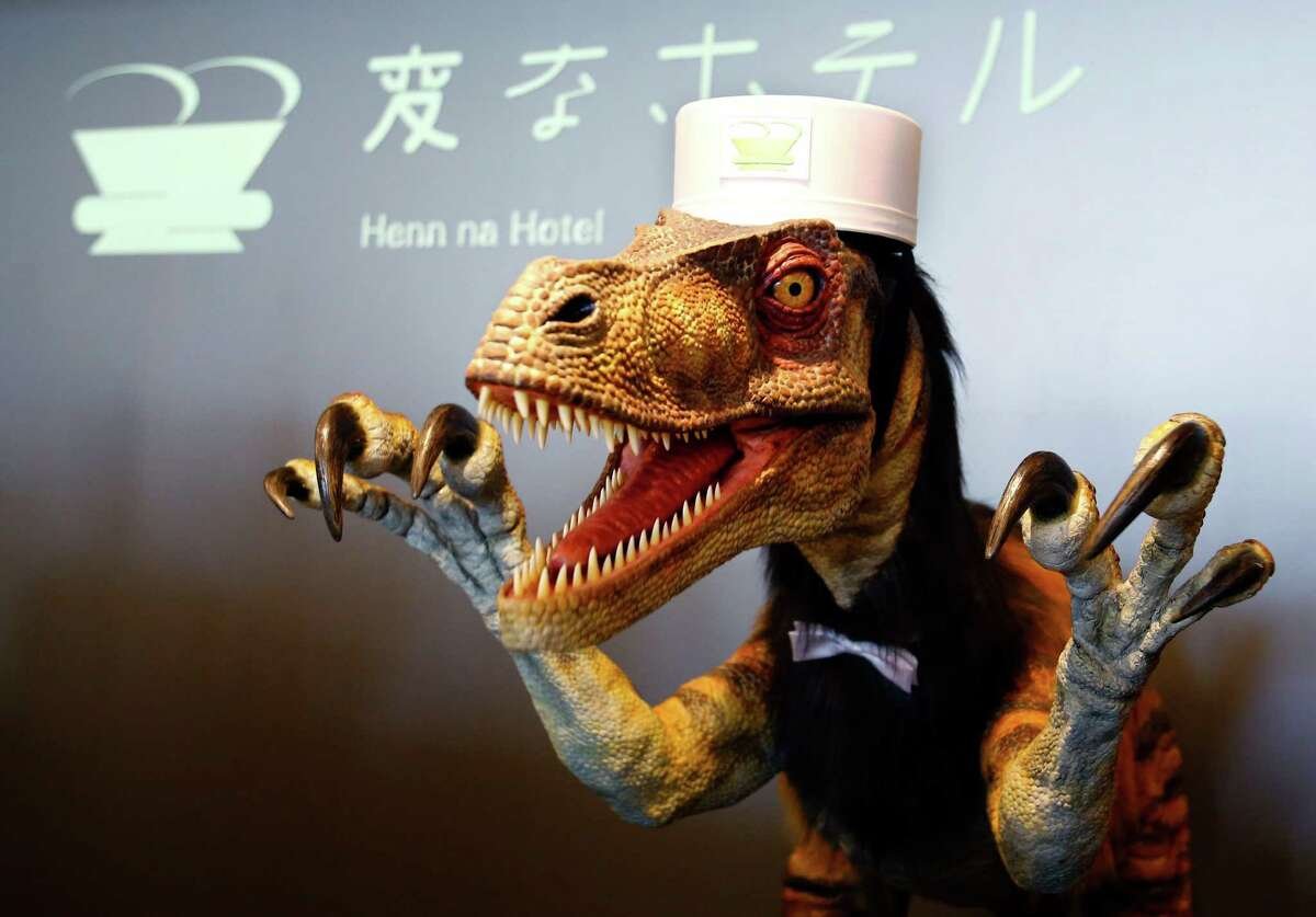 A receptionist dinosaur robot performs at the new robot hotel, aptly called Henn na Hotel or Weird Hotel, in Sasebo, southwestern Japan. From the receptionist that does the check-in and check-out to the porter thats a stand-on-wheels taking luggage up to the room, the hotel, that is run as part of Huis Ten Bosch amusement park, is manned almost totally by robots to save labor costs.