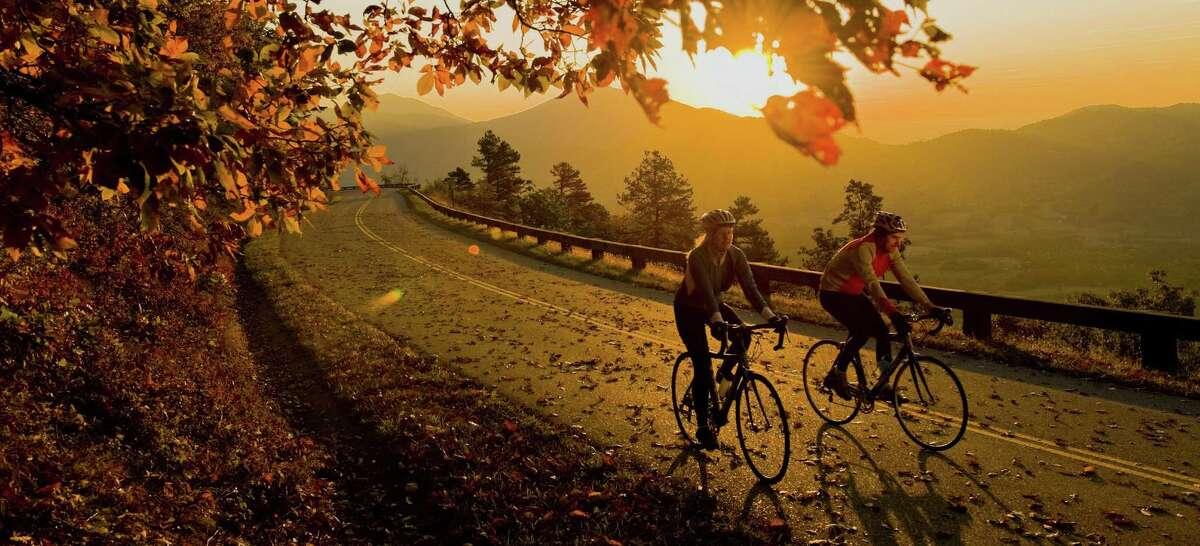Autumn bike riders travel along the Blue Ridge Parkway near Peaks of Otter, Va.