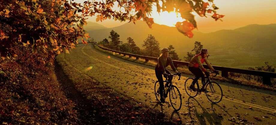 Autumn bike riders travel along the Blue Ridge Parkway near Peaks of Otter, Va. Photo: Scott K. Brown /TNS / Virginia Department of Tourism