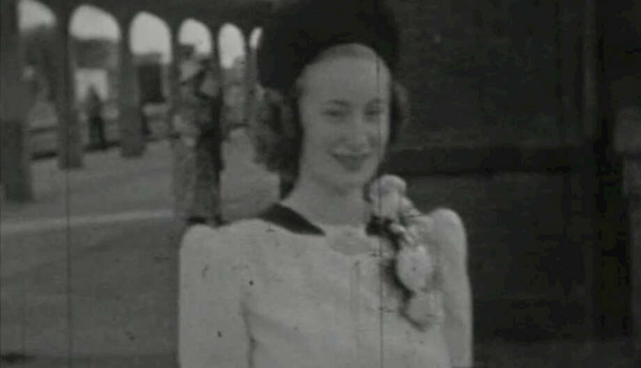 Mildred Frank Yount Manion at the Beaumont Santa Fe depot as she departed on the trip to Lexington. Mildred was sent to Kentucky due to concerns of Southeast Texas being attacked during World War II. Circa early 1940s. Footage provided by The Lamar Library