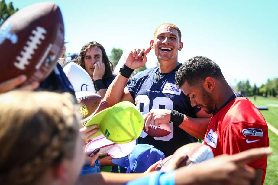 Seahawks players Jimmy Graham and Russell Wilson sign autographs during the first day of Seahawks training camp at the Virginia Mason Athletic Facility in Renton. Photographed on Friday, July 31, 2015. (Joshua Trujillo, seattlepi.com) Photo: JOSHUA TRUJILLO, SEATTLEPI.COM