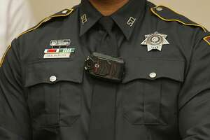 A Harris County Sheriff Deputy wears a camera during a press conference announcing Harris County District Attorney Devon Anderson's plan to purchase body cameras for the Harris County Sheriff Department and the Houston Police Department Friday, Dec. 12, 2014, in Houston.   ( James Nielsen / Houston Chronicle )