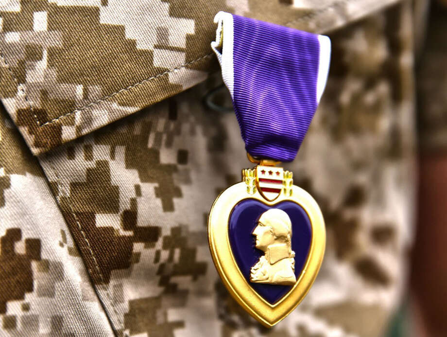 A Purple Heart commendation, similar to the one picture, was found in a Dumpster in Midland, Texas. An Army veteran is now trying to track down the World War II veteran whose name, Jim C. Hall, is on the medal. Click through to see where many of the medals are made. Photo: HANDOUT, STR / THE WASHINGTON POST