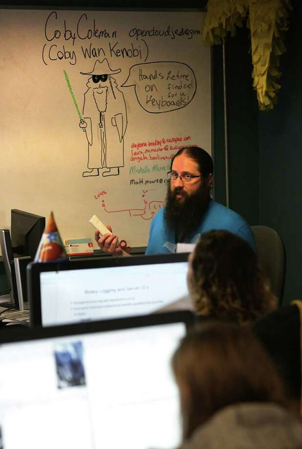 "Coby Coleman, lead Linux instructor for Rackspace's ""Linux for Ladies"" class, teaches at the Open Cloud Academy in the Weston Centre on Monday, July 6, 2015. Photo: Bob Owen /San Antonio Express-News / San Antonio Express-News"