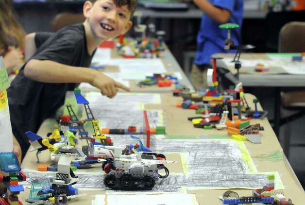 "Eight-year-old Aiden ""Ace"" Roy works with his team on their Lego Robotics machine at MiSci the museum of innovation and science on Friday July 31, 2015 in Schenectady, N.Y. (Michael P. Farrell/Times Union) Photo: Michael P. Farrell / 10032836A"