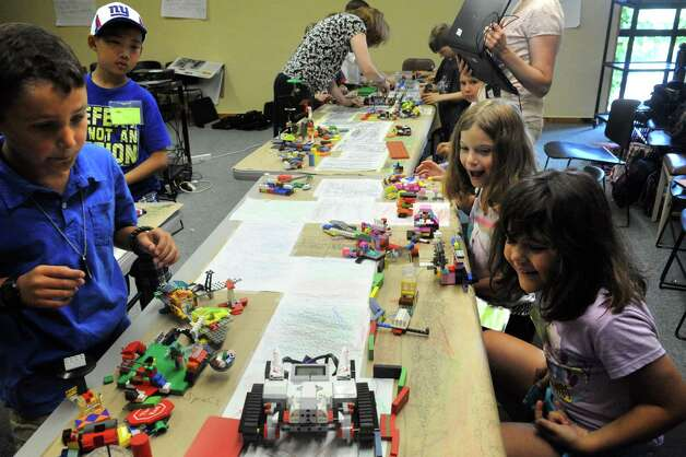 Thirty kids ages entering grades 3 - 6 learned about Lego Robotics at MiSci the museum of innovation and science on Friday July 31, 2015 in Schenectady, N.Y. (Michael P. Farrell/Times Union) Photo: Michael P. Farrell / 10032836A