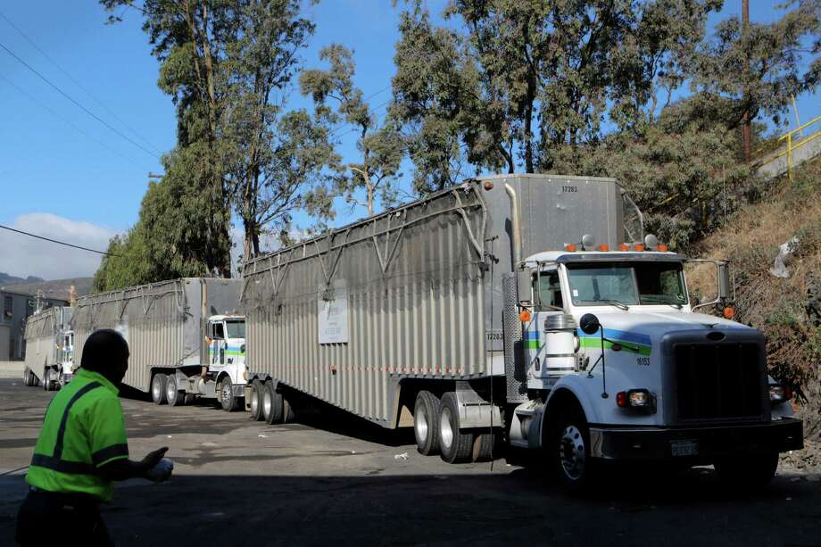 Long haul transfer trucks wait to be loaded with garbage at the Recology San Francisco Transfer Station in San Francisco, CA, on Friday, July 24, 2015. The trucks take the refuse to the Altamont Landfill in Livermore, CA. Photo: Loren Elliott / The Chronicle / ONLINE_YES