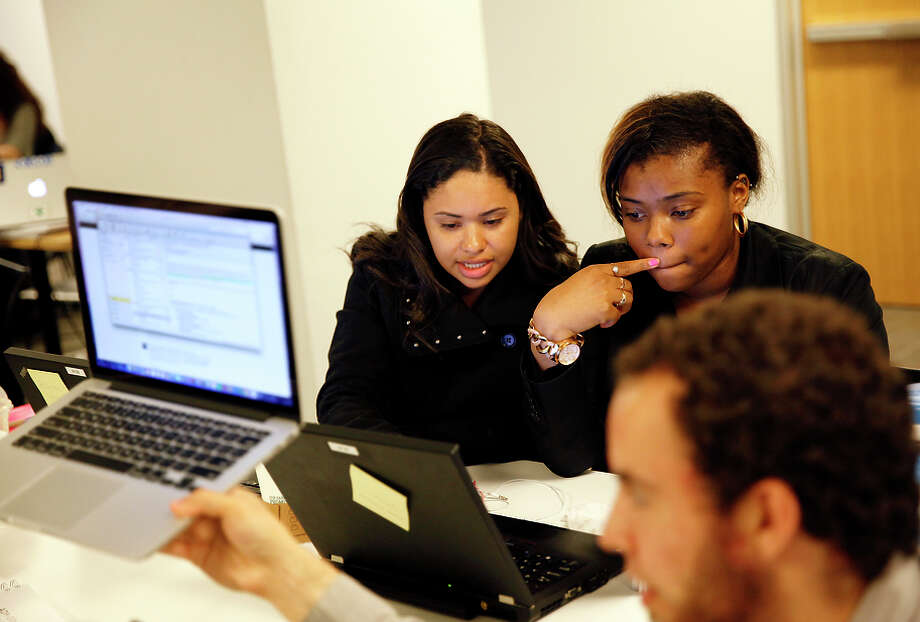 Angelica Pineda (left) and Jiana Fontenot work together in one of their classes at Year Up in San Francisco. Photo: Sarah Rice / Sarah Rice / Special To The Chronicle / ONLINE_YES