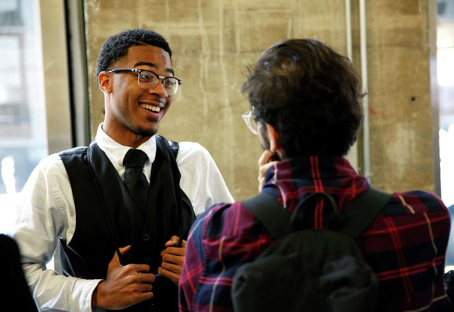 Eric Mason, who learned how to be himself with a professional demeanor at Year Up in San Francisco, jokes with other students. Photo: Sarah Rice / Sarah Rice / Special To The Chronicle / ONLINE_YES