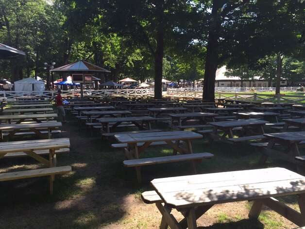 This is where the not for free picnic tables are at Saratoga Race Course. I have no problem if the New York Racing Association wants to put aside some tables for people to pay for. Some just don't want to get up early and fight the crowds on big race days. I get that. What I don't like is this: the tables are way too close together. When that area gets all jammed up, I don't think I would want to be so close to the  next table that I could smell their tuna salad. Also don't like the idea of putting these tables right on top of the paddock. That means a lot of people will not be able to get a close up view of the horses when they are in the saddling area. And that stinks. But, that is also just me. —Tim Wilkin