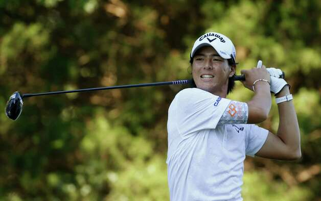 Ryo Ishikawa, of Japan, grimaces as he watches his tee shot on the 18th hole to put him in the lead during the second round of the Quicken Loans National golf tournament at the Robert Trent Jones Golf Club in Gainesville, Va., Friday, July 31, 2015. Ishikawa is 11-under-par for the two rounds.  (AP Photo/Steve Helber) ORG XMIT: VASH122 Photo: Steve Helber / AP