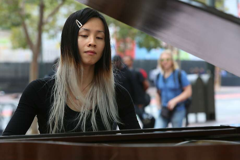 Serene Han plays the grand piano at U.N. Plaza. Photo: Liz Hafalia, The Chronicle