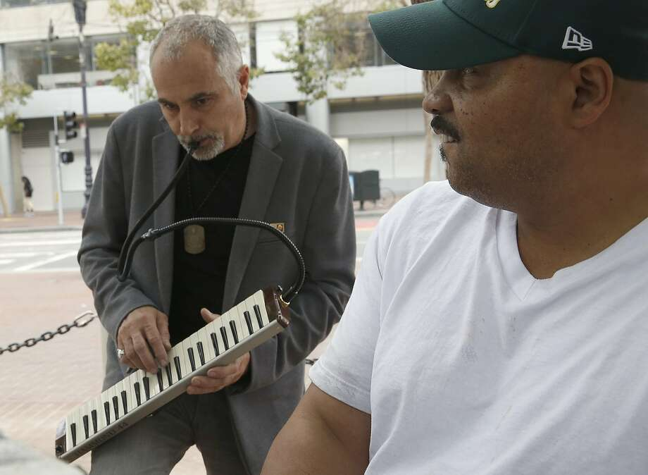 Artist Mauro ffortissimo (left, last name spelt with lowercase f's) plays the melodica as John Weaver (right) from San Francisco plays the grand piano at the U.N. Plaza in San Francisco, Calif., on Friday, July 31, 2015. Photo: Liz Hafalia, The Chronicle