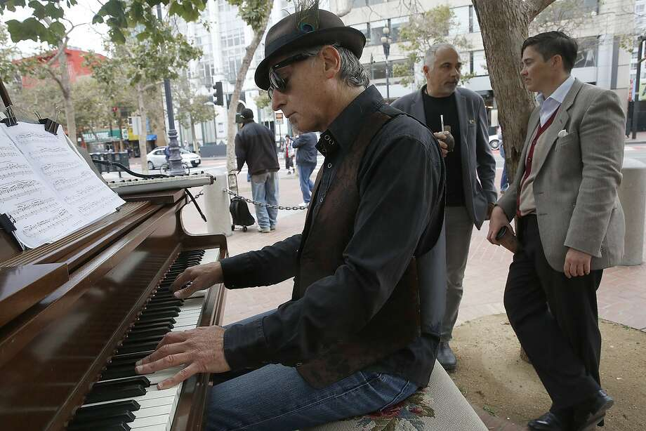 Artist and director Dean Mermell plays the grand piano at the U.N. Plaza in San Francisco, Calif., on Friday, July 31, 2015.  He will play at the UN Plaza between 11-2pm on Fridays for the next few months. Photo: Liz Hafalia, The Chronicle