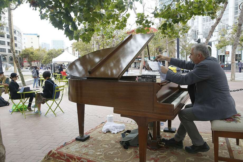 Artist Mauro ffortissimo (last name spelt with lowercase f's) plays the melodica and grand piano at the U.N. Plaza in San Francisco, Calif., on Friday, July 31, 2015.  He will play at the UN Plaza between 11-2pm on Fridays for the next few months. Photo: Liz Hafalia, The Chronicle