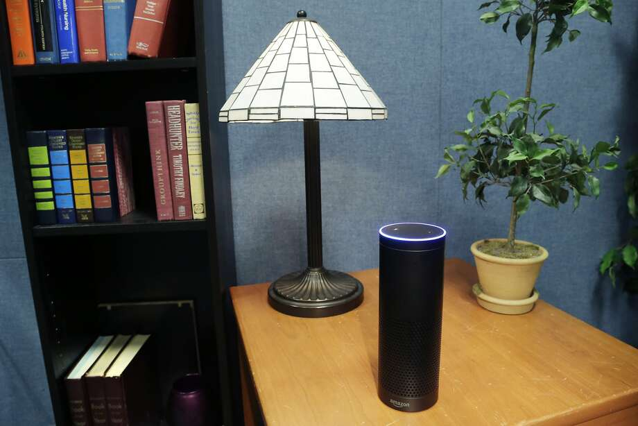 Amazon's Echo, a digital assistant that can be set up in a home or office to listen for various requests, such as for a song, a sports score, the weather, or even a book to be read aloud, is shown, Wednesday, July 29, 2015 in New York. The $180 cylindrical device is the latest advance in voice-recognition technology that's enabling machines to record snippets of conversation that are analyzed and stored by companies promising to make their customers' lives better. (AP Photo/Mark Lennihan) Photo: Mark Lennihan, Associated Press