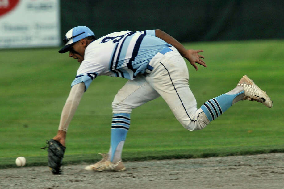 Stamford shortstop Randy Polonia dives unsuccessfully for the RCP-hit ball during game one of their Senior American Legion State Championships at Palmer Field in Middletown, Conn., on Friday, July 31, 2015. RCP won, 6-5. Photo: Jason Rearick / Hearst Connecticut Media / Stamford Advocate