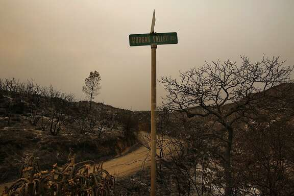 The area around the road into a property on Morgan Valley Road was completely burned during the Rocky fire as it continued to burn in Lake County July 31, 2015 near Lower Lake, Calif.