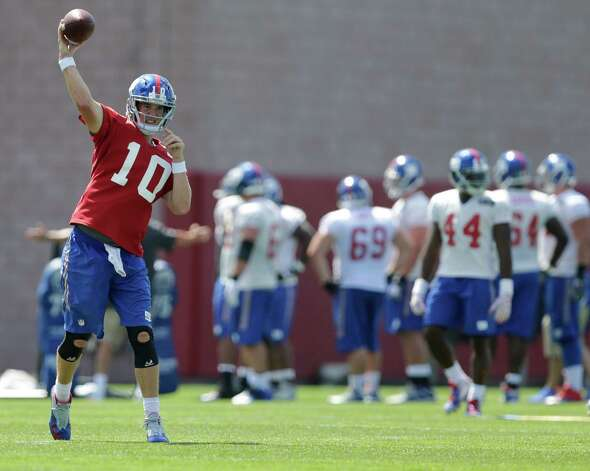 New York Giants quarterback Eli Manning (10) throws a pass during practice at NFL football training camp, Friday, July 31, 2015, in East Rutherford, N.J. (AP Photo/Frank Franklin II) ORG XMIT: NJFF112 Photo: Frank Franklin II / AP