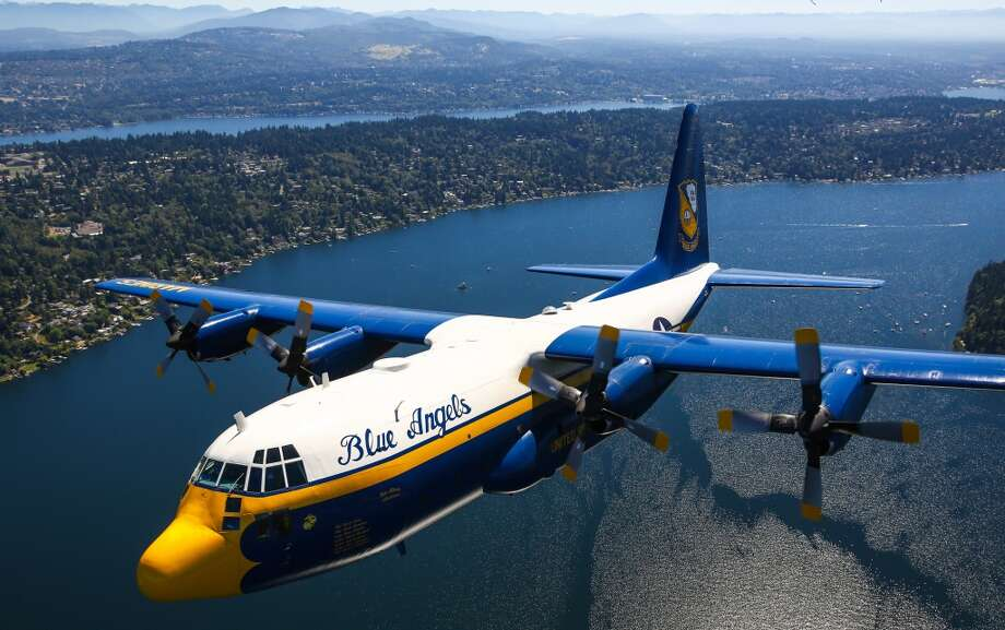 The U.S. Navy Blue Angels C-130, Fat Albert, flies over Seattle as the team prepares for Seafair. Seafair, the traditional summer  Seattle festival, brings hydroplane boats to Lake Washington and aircraft to the skies above for the weekend Boeing Airshow. Photographed on Thursday, July 30, 2015. (Joshua Trujillo, seattlepi.com) Photo: JOSHUA TRUJILLO, SEATTLEPI.COM
