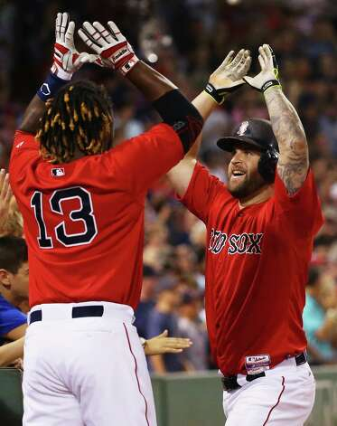 BOSTON, MA - JULY 31: Hanley Ramirez #13 of the Boston Red Sox congratulates Mike Napoli #12 after he hit a two run homer during the seventh inning against the Tampa Bay Rays at Fenway Park on July 31, 2015 in Boston, Massachusetts.  (Photo by Maddie Meyer/Getty Images) ORG XMIT: 538587721 Photo: Maddie Meyer / 2015 Getty Images