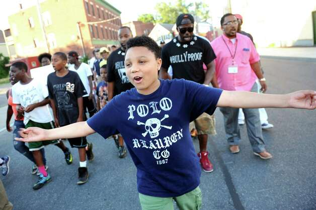Damonni Farley Jr., 10, leads the community as they protest street violence on Friday, July 31, 2015, in Schenectady, N.Y.  (Cindy Schultz / Times Union) Photo: Cindy Schultz / 10032832A