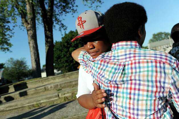 Khalil Woodson, 16, left, who lost his brother LaSean Gause, 19, receives support during a community gathering to protest street violence on Friday, July 31, 2015, in Schenectady, N.Y. (Cindy Schultz / Times Union) Photo: Cindy Schultz / 10032832A