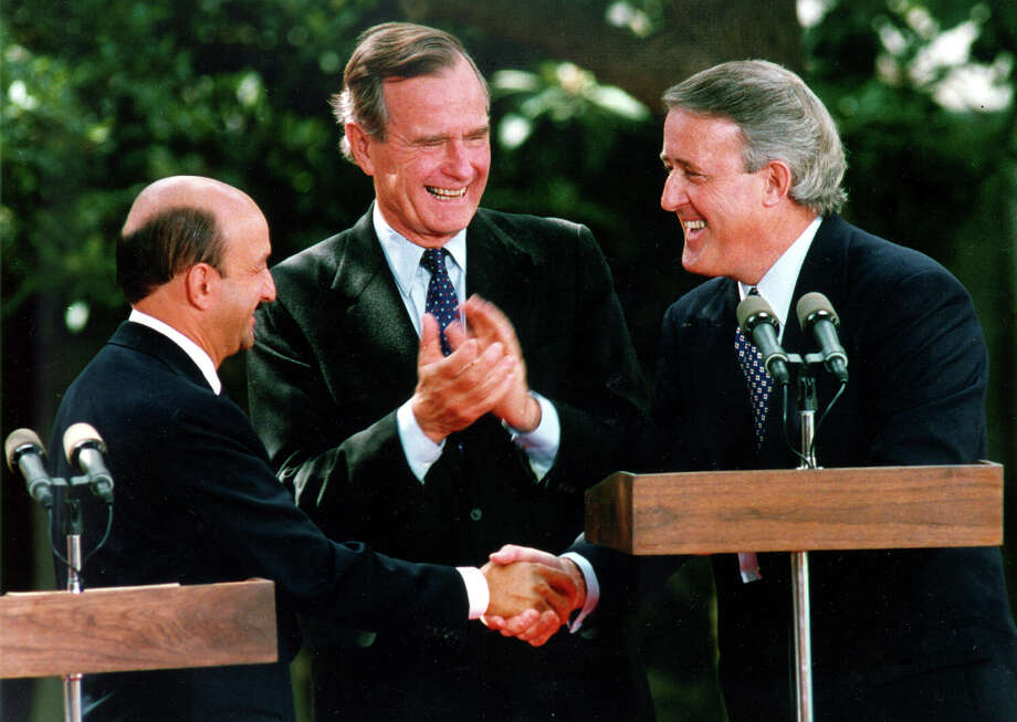 Mexican President Carlos Salinas de Gortari, U.S. President George H.W. Bush and Canadian Prime Minister Brian Mulroney exchange handshakes following Salinas' address before the Free Trade Agreement initaling ceremony Nov. 7, 1992, at the Plaza San Antonio Hotel. Photo: Express-News File Photo / SAN ANTONIO EXPRESS-NEWS
