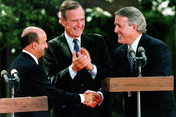 Mexican President Carlos Salinas de Gortari, U.S. President George H.W. Bush and Canadian Prime Minister Brian Mulroney exchange handshakes following Salinas' address before the Free Trade Agreement initaling ceremony Nov. 7, 1992, at the Plaza San Antonio Hotel.